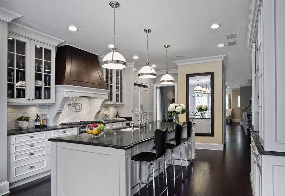 Front Range Lumber for a Traditional Kitchen with a Pendant Lights and Elegantly Detailed Kitchen by Tzs Design
