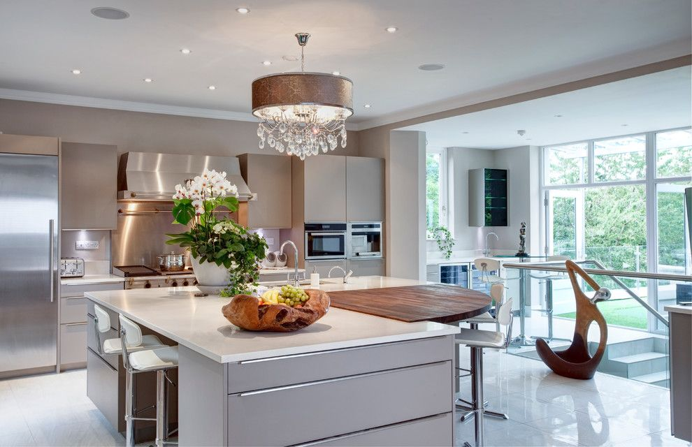 Fruit Flies in Kitchen for a Transitional Kitchen with a White Worktop and Making the Most of a Challenging, Sloping Site to Create an Elegant Yet Function by Des Ewing Residential Architects