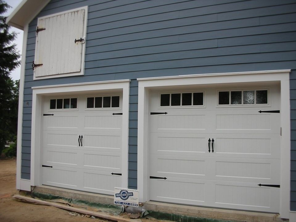 Garage Northville for a Farmhouse Garage with a Wood Garage Door and Carriage House Garage Doors by Premier Door Service