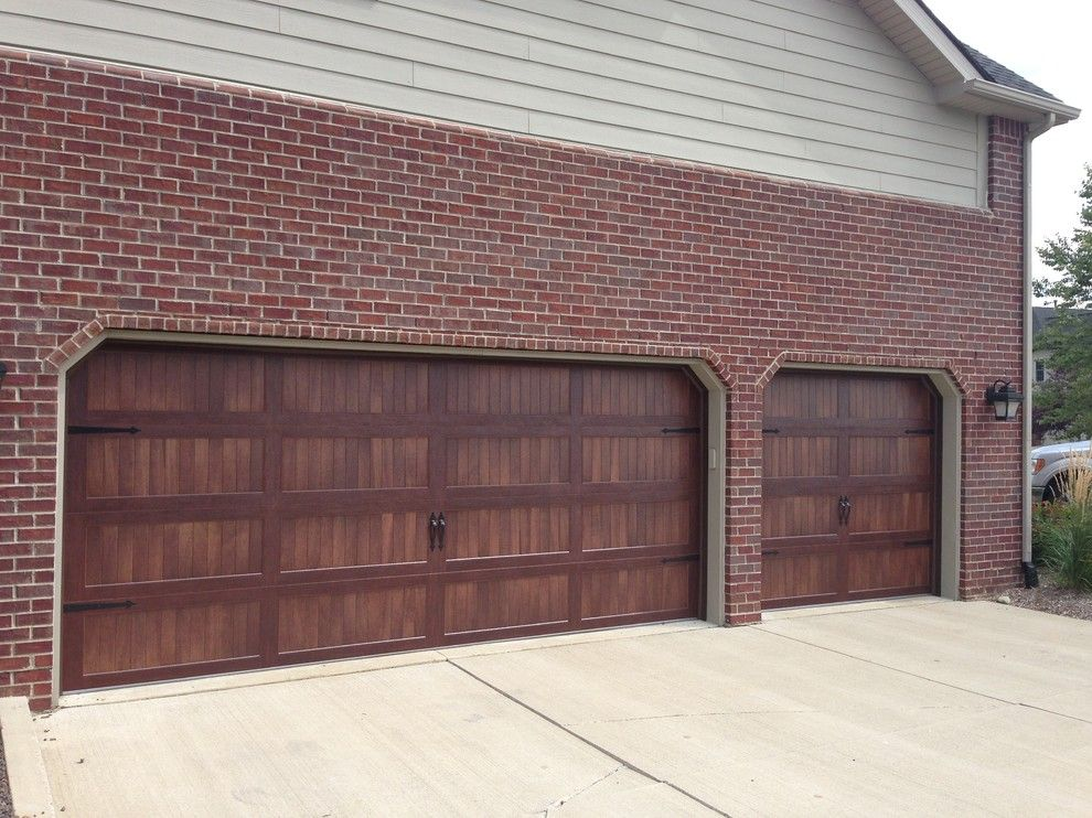 Garage Northville for a Traditional Garage with a Garage Door and Faux Wood Garage Doors by Premier Door Service