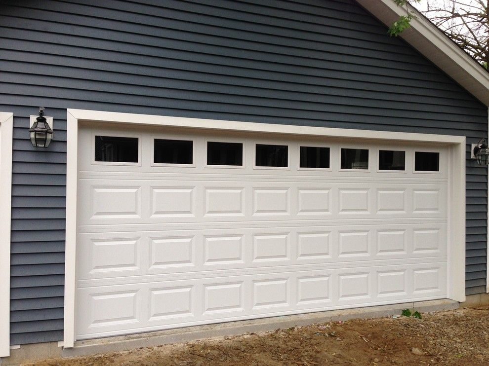 Garage Northville for a Traditional Garage with a Garage Door and Traditional Raised Panel Garage Doors by Premier Door Service