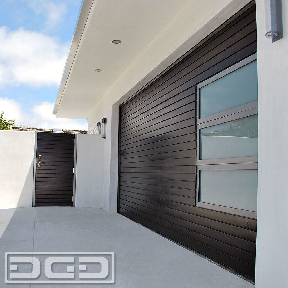 Garagetek for a Modern Shed with a Modern Landscaping and Modern Garage Door, Matching Pedestrian Gates & Steel Architectural Entry Gates by Dynamic Garage Door