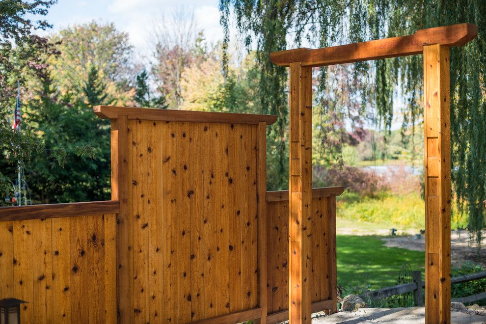Gardenscapes for a Asian Landscape with a Ann Arbor and Japanese Style Cedar Gate by Lotus Gardenscapes & Bloom Garden Center