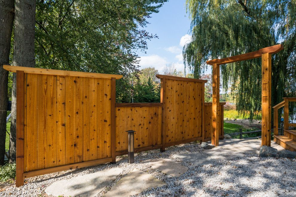 Gardenscapes for a Asian Landscape with a Bloom Gardens and Japanese Style Cedar Gate by Lotus Gardenscapes & Bloom Garden Center