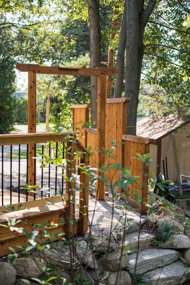 Gardenscapes for a Asian Landscape with a Michigan and Japanese Style Cedar Gate by Lotus Gardenscapes & Bloom Garden Center