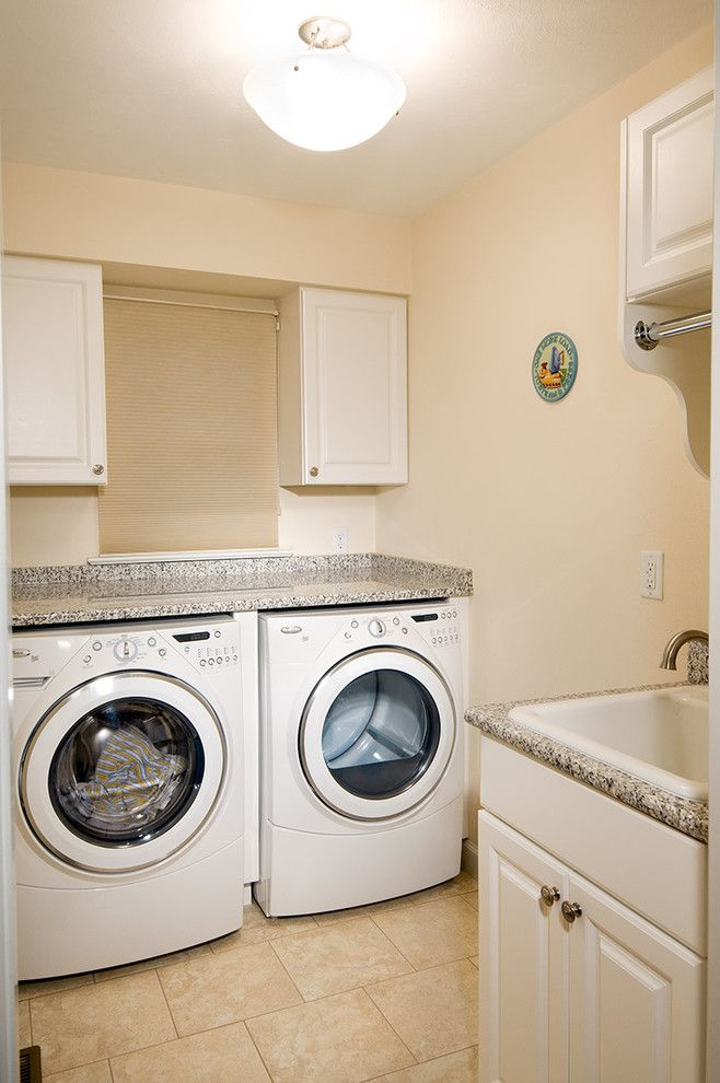 Gas Dryer vs Electric Dryer for a Traditional Laundry Room with a Utility Sink and Laundry Room by Benson Homes Llc