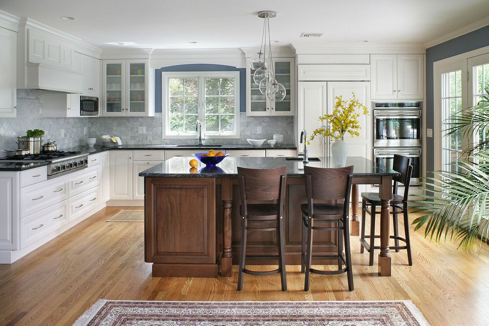Gas Dryer vs Electric for a Transitional Kitchen with a Dark Wood Island and White Transitional Kitchen by Thyme & Place Design Llc