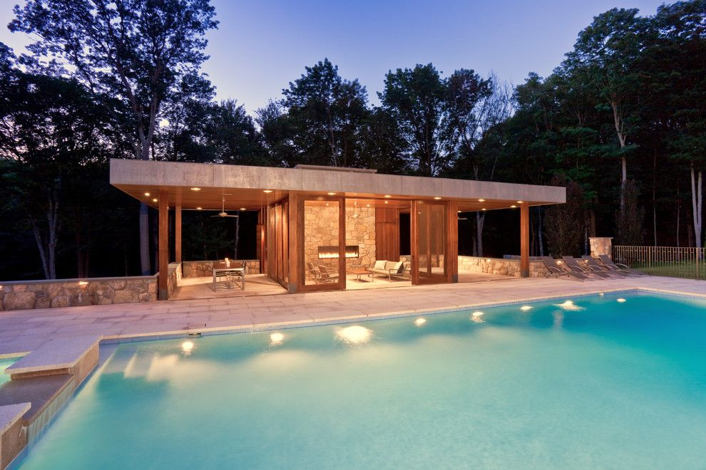 Glass House New Canaan for a Modern Pool with a Fence and Modern Pool House by Jablonski Associates