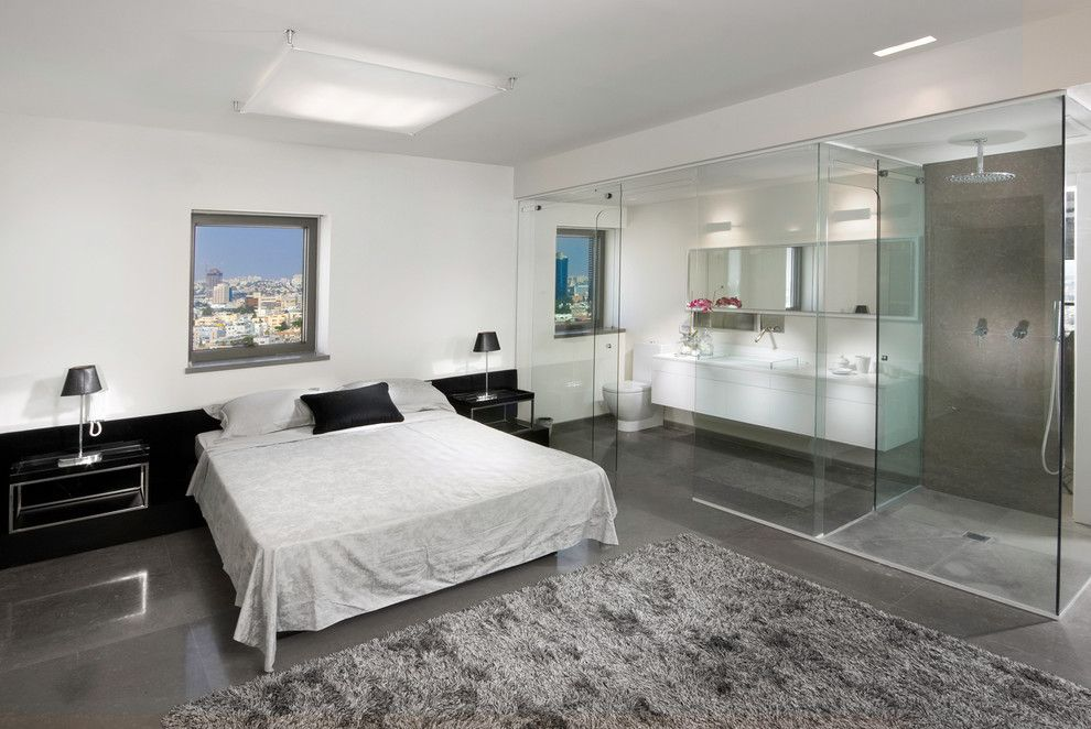 Glassed for a Contemporary Bedroom with a Concrete and Bedroom by Elad Gonen