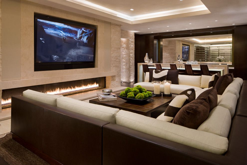 Glen Cove Theater for a Contemporary Family Room with a Tray Ceiling and Willoughby Way by Charles Cunniffe Architects Aspen