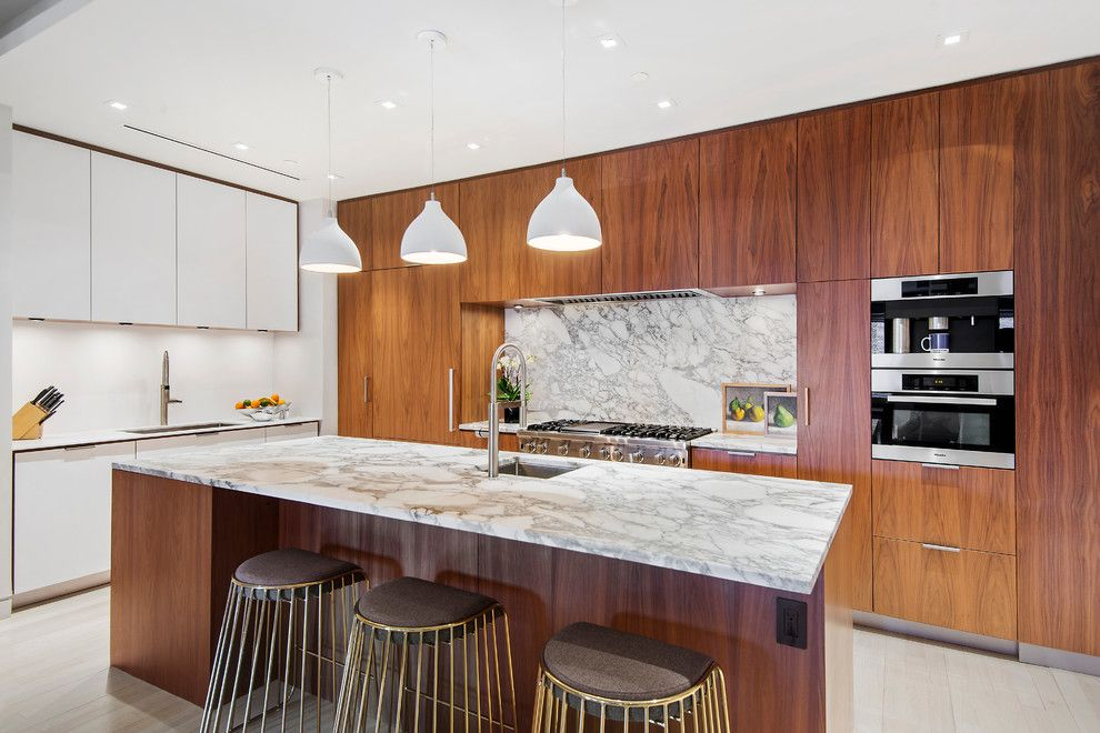 Gotham Lighting for a Contemporary Kitchen with a Custom Design and 545 West 20th Street | $6,995,000 by the Noble Black Team at Douglas Elliman