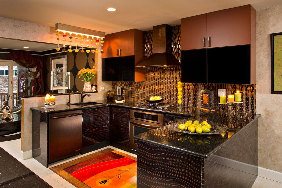 Gotham Lighting for a Eclectic Kitchen with a Mixed Patterns and Glittering Heights by Teakwood Builders, Inc.