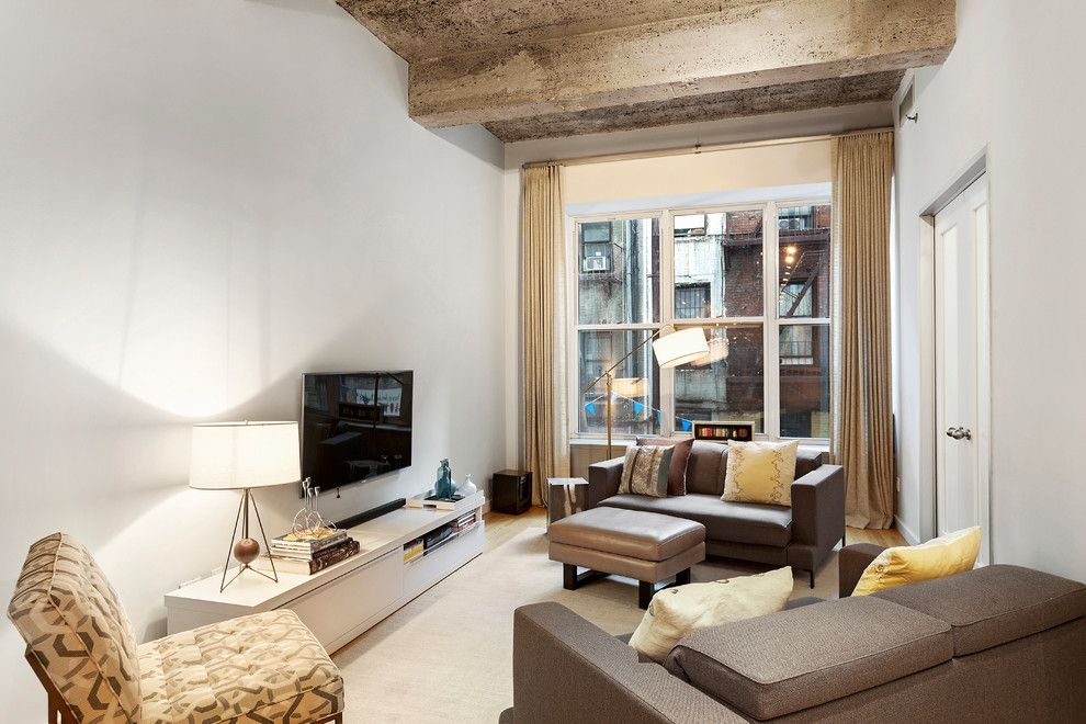 Gotham Lighting for a Industrial Living Room with a Hardwood Floors and 419 West 55 Street | $1.15m by the Noble Black Team at Douglas Elliman