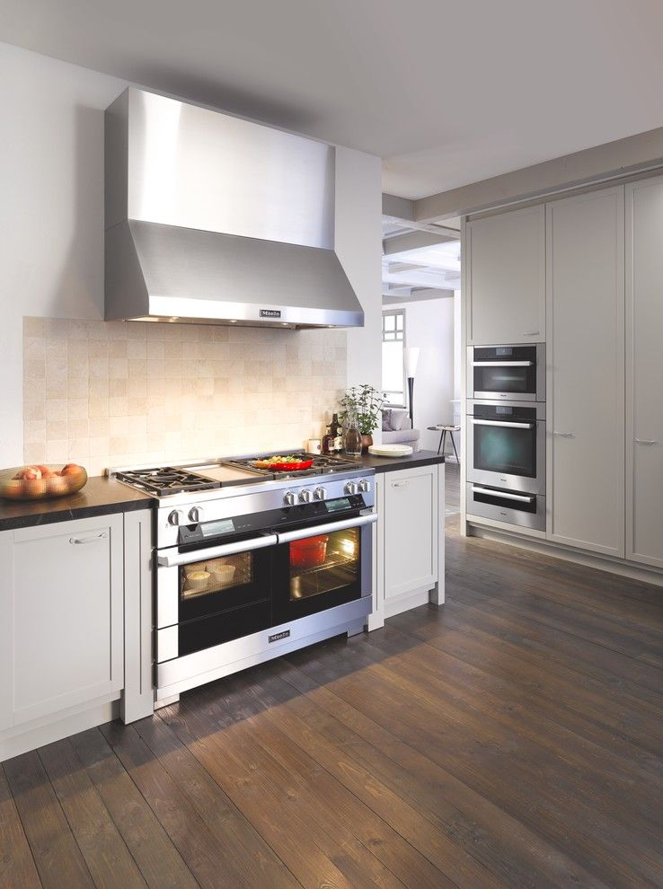 Great Dane Harlequin for a Contemporary Kitchen with a Dark Wood Flooring and Miele by Miele Appliance Inc