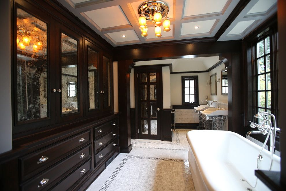 Greek Revival Homes for a Traditional Bathroom with a Dark Wood Pillar and Henry Viii Inspired Bathroom by Mfm Design & Construction Llc