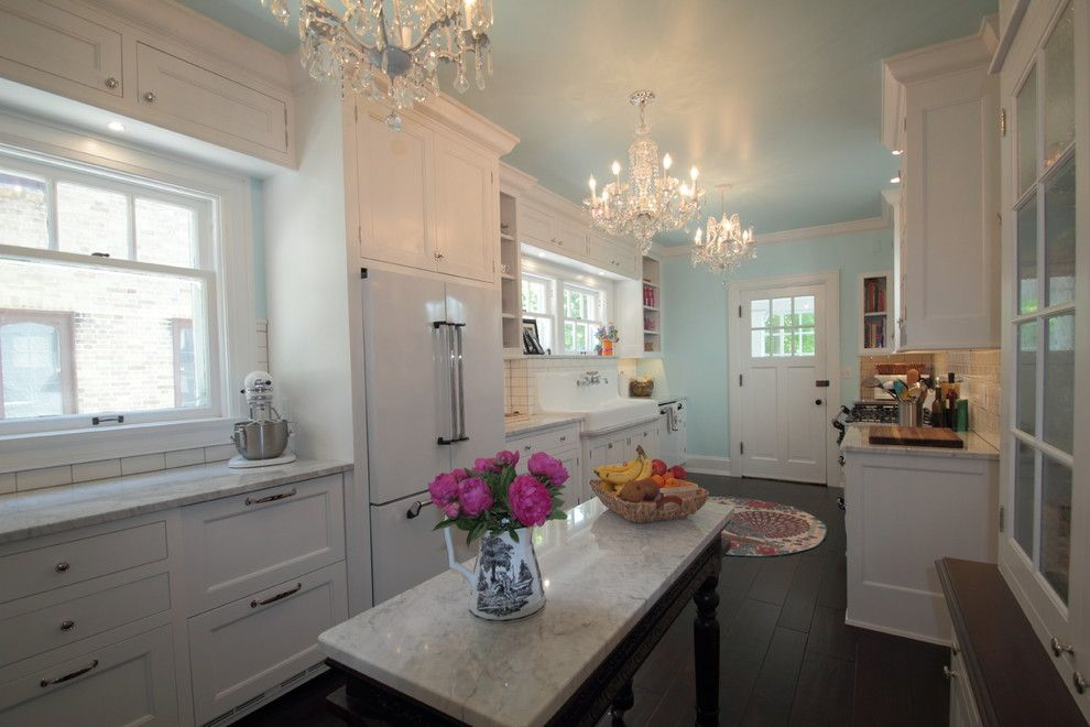 Grote Lighting for a Farmhouse Spaces with a White Cabinets and Tudor Kitchen by Cream City Construction