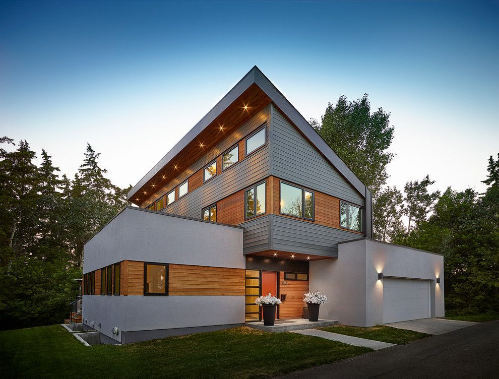 Hardie Trim for a Contemporary Exterior with a Stucco Siding and Millcreek House by Effect Home Builders Ltd.