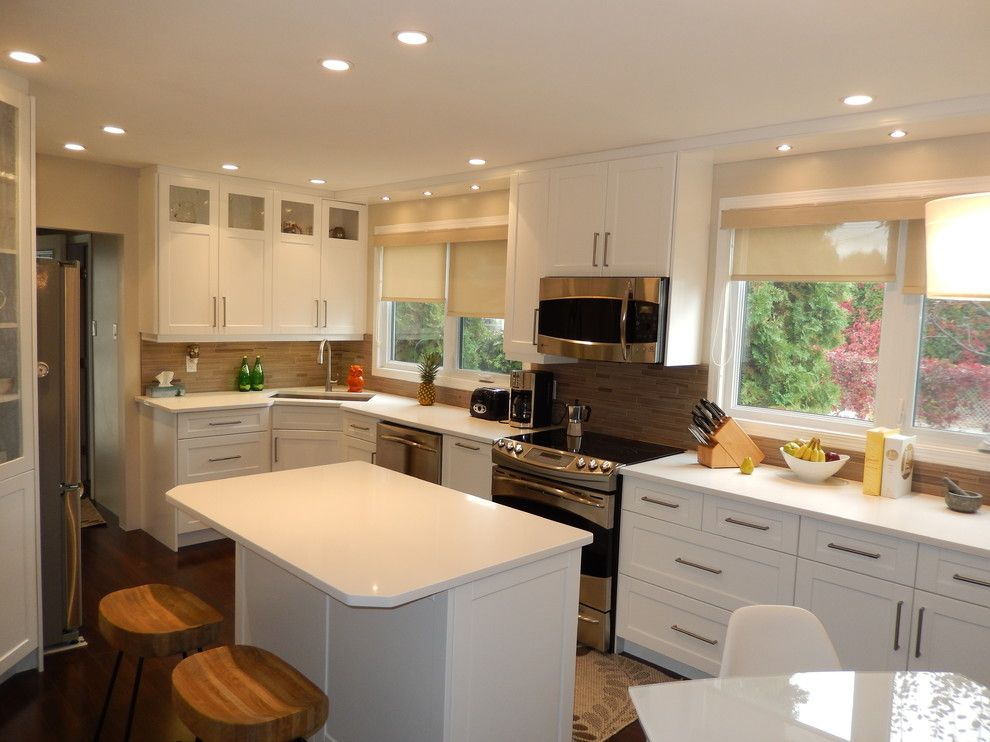 Hawthorne Appliances for a Transitional Kitchen with a Caesarstone Countertops and Transitional   White Shaker Kitchen by Hawthorne Kitchens