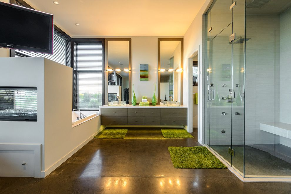 H&c Concrete Stain for a Contemporary Bathroom with a Framed Mirrors and Dwell on Despard by Joshua Lawrence Studios Inc