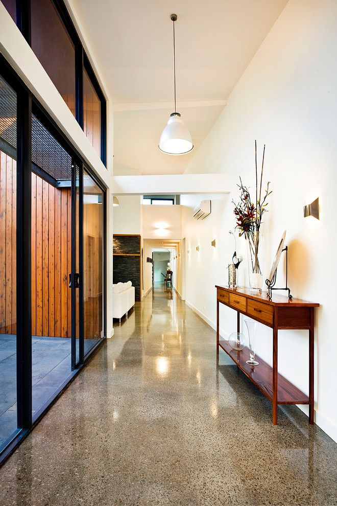 h&c Concrete Stain for a Contemporary Hall with a Glossy Floor and Red Hill Residence by Architecture Matters Pty. Ltd.