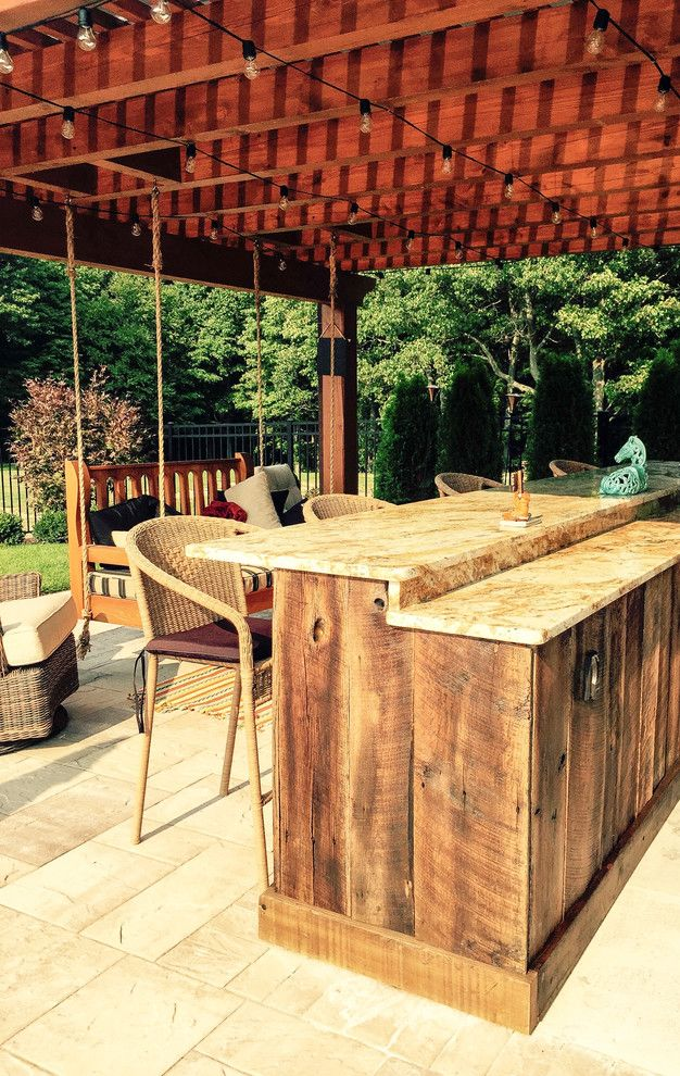 Hearth and Grill for a Rustic Pool with a Landscaping Troy and Pool Project Clifton Park, Ny by Pearl Landscaping & Patio Company