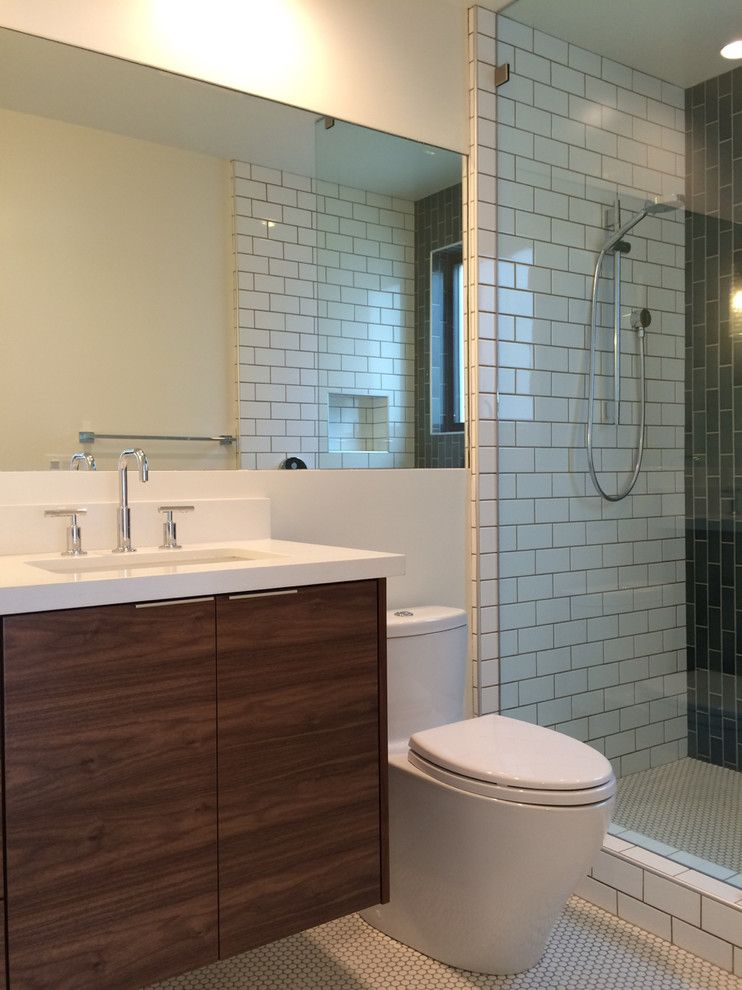 Heath Ceramics for a Midcentury Bathroom with a La Jolla and Bath with Walnut Vanity, Recessed Mirror, Subway Tile, and Heath Ceramics Blue T by Nau Builders, Inc.