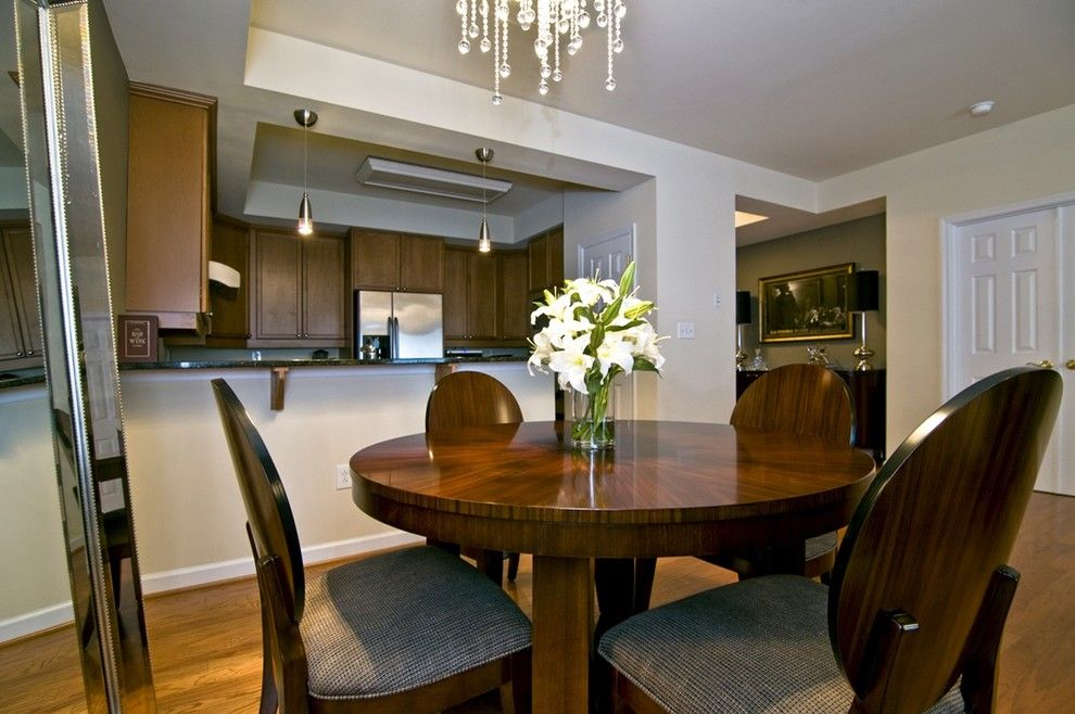 Helping Hands Richmond for a Modern Dining Room with a Custom Ceiling Mounted Drapery and Modern Downtown Loft Living & Dining Room by R Webb Interiors Design Firm