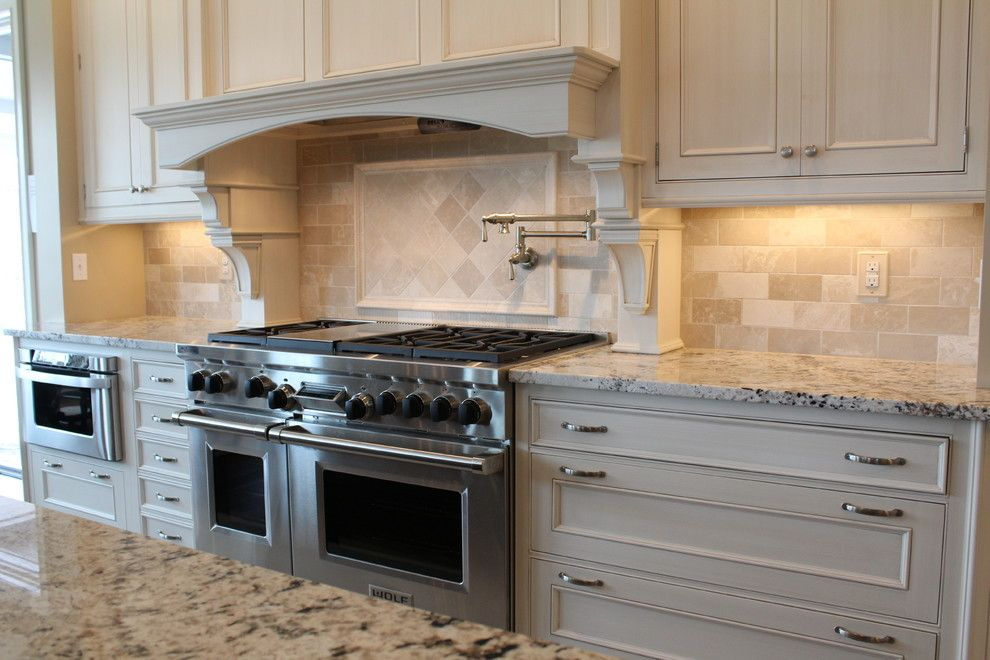 Hideaway Storage for a Traditional Kitchen with a Custom Backsplash and Almond Beige Marble Collection by Best Tile