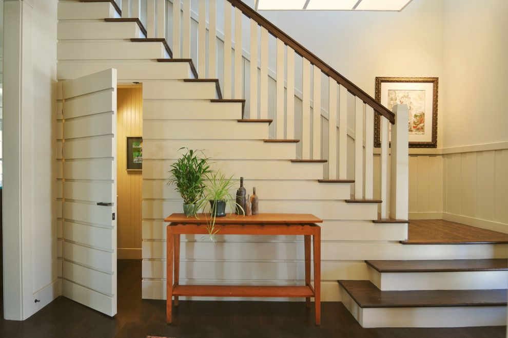 Hideaway Storage for a Traditional Staircase with a Chair Rail and Lakeview Park Renovation by Alchemy Design Studio