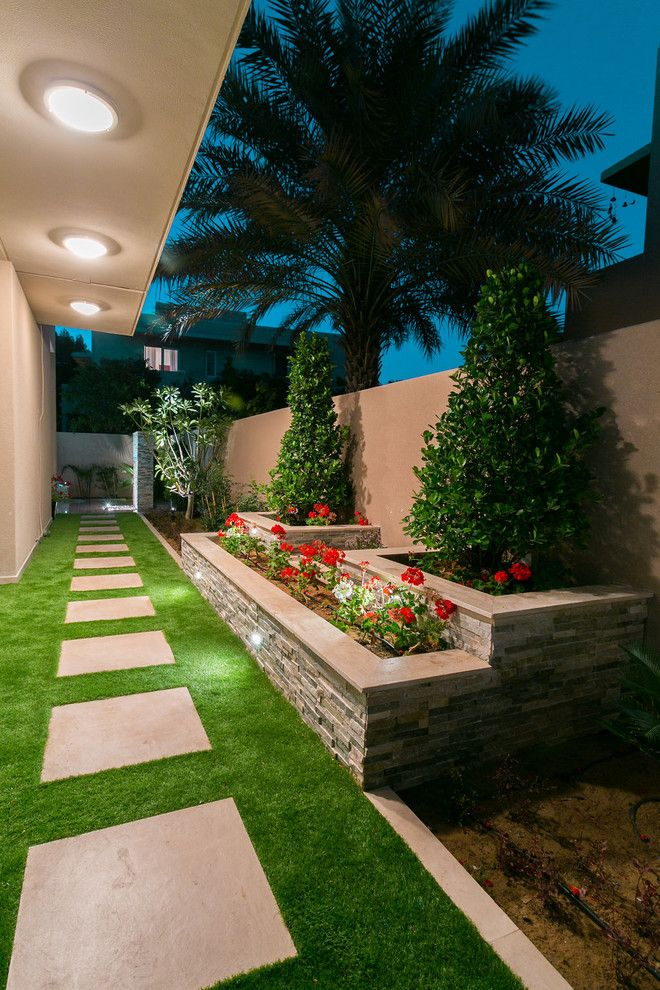 Hilliard Lawn and Garden for a Contemporary Landscape with a Recessed Lighting and Ranches by Hortus Grass Artificial Turf Solutions in Dubai