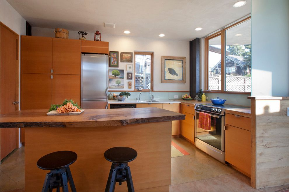 Home Improvement Cast for a Eclectic Kitchen with a Live Edge Counter Top and Mcgee Salvage House by Leger Wanaselja Architecture