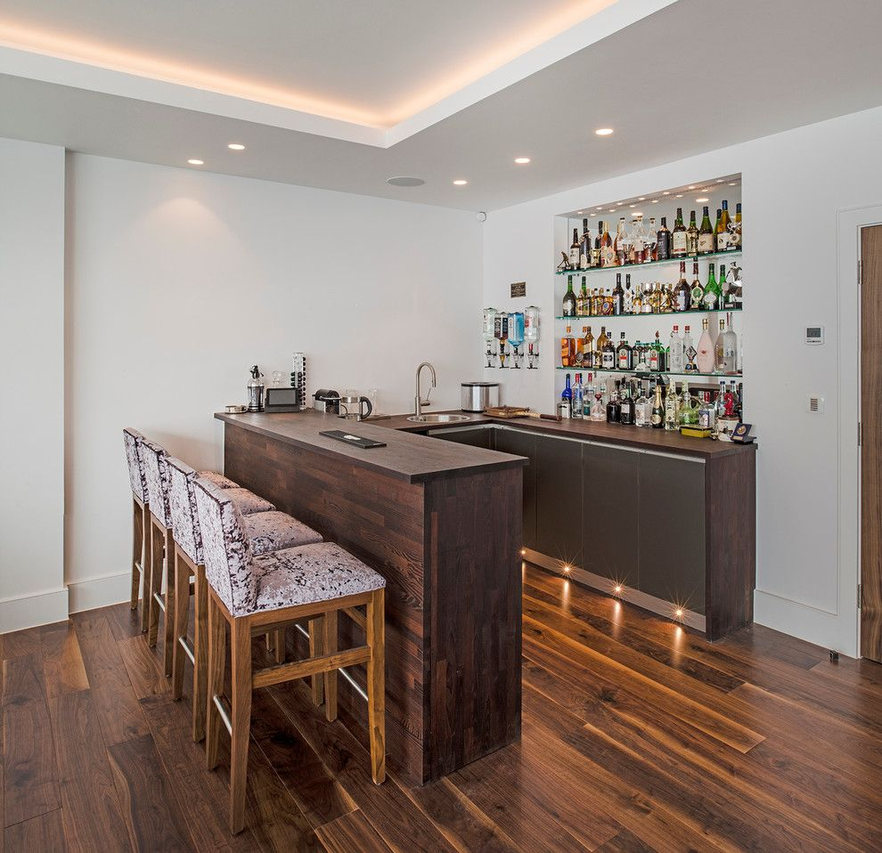 Homesmart Realty for a Contemporary Home Bar with a Home Bar Designs and in the Corner of the Games/family Room, a Home Bar. by London Basement
