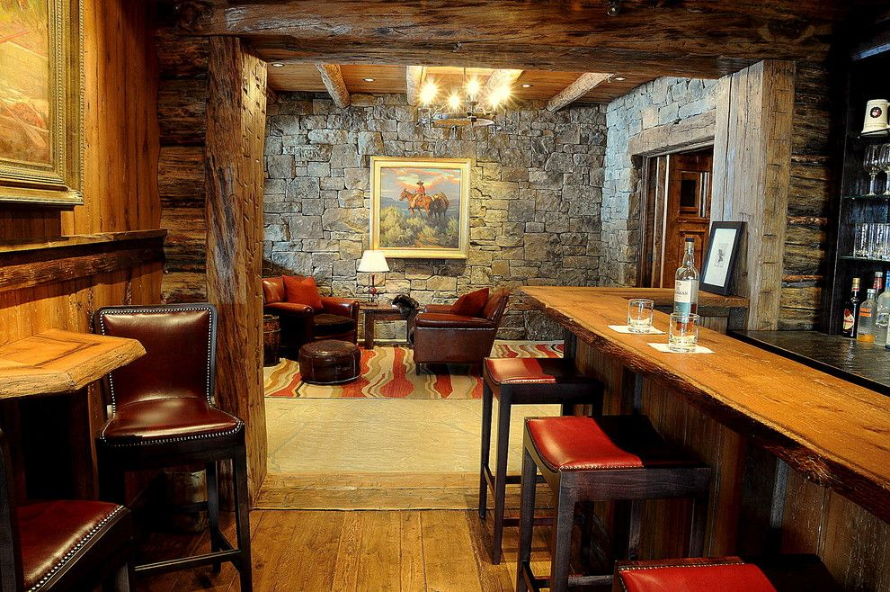 Homesmart Realty for a Rustic Family Room with a Stone Wall and Bar/sitting Room by Peace Design