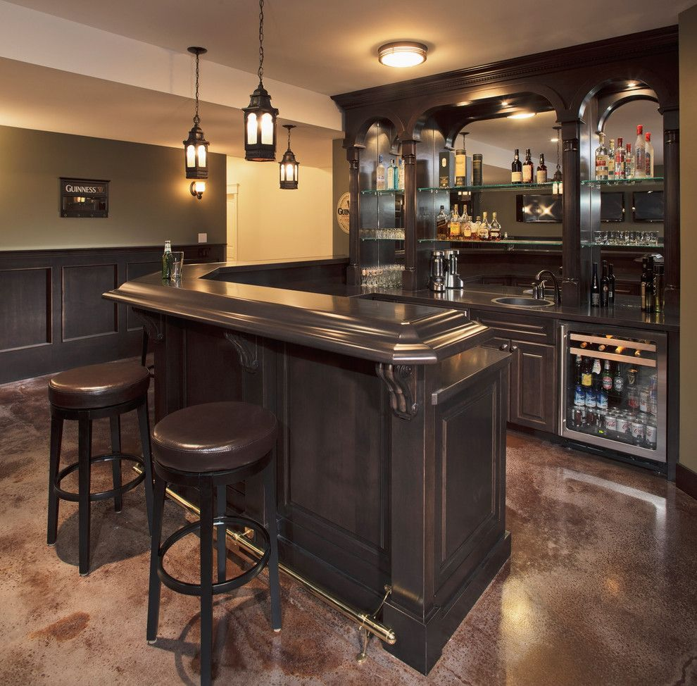 Hometeam Properties for a Traditional Home Bar with a Wainscot and West Hillhurst Escape by Stephens Fine Homes Ltd
