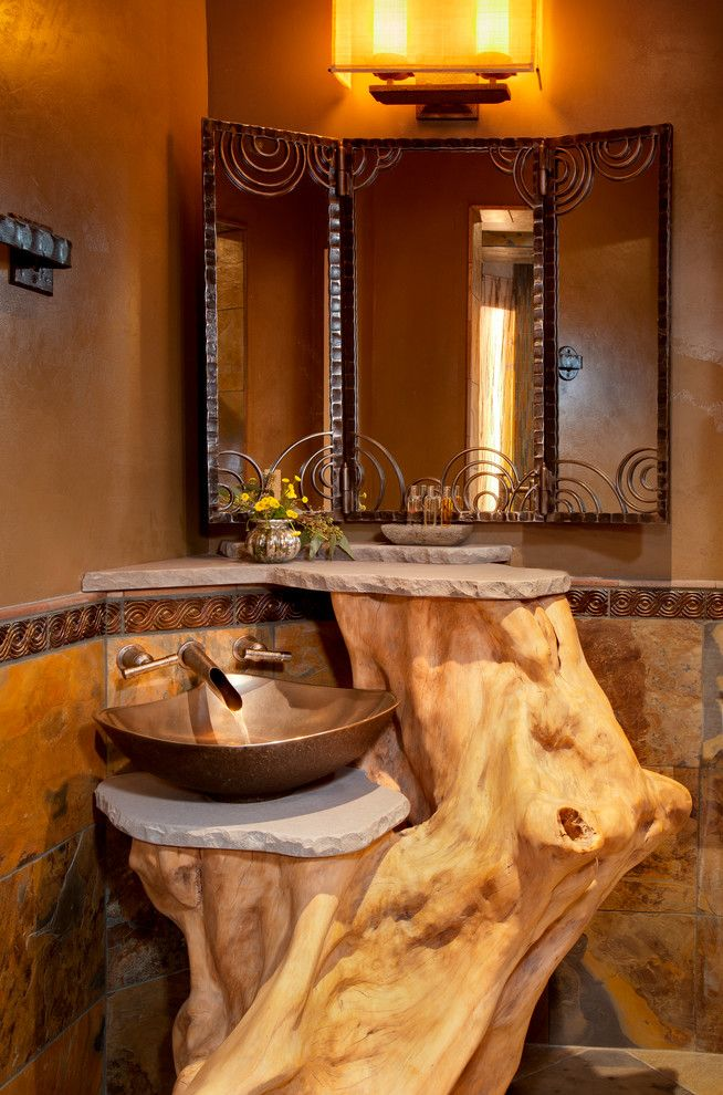 Homewise Santa Fe for a Mediterranean Powder Room with a Natural and Historic Charmer in Santa Fe by Samuel Design Group