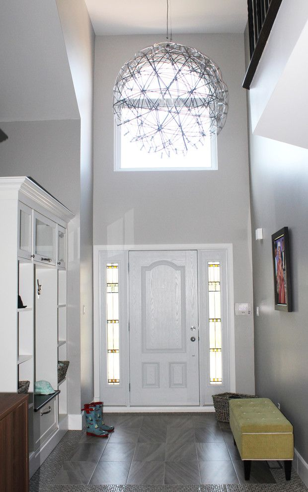 Hooked on Ornaments for a Contemporary Entry with a Family Room and a Young Family's Happy , Safe, Home by Toc Design