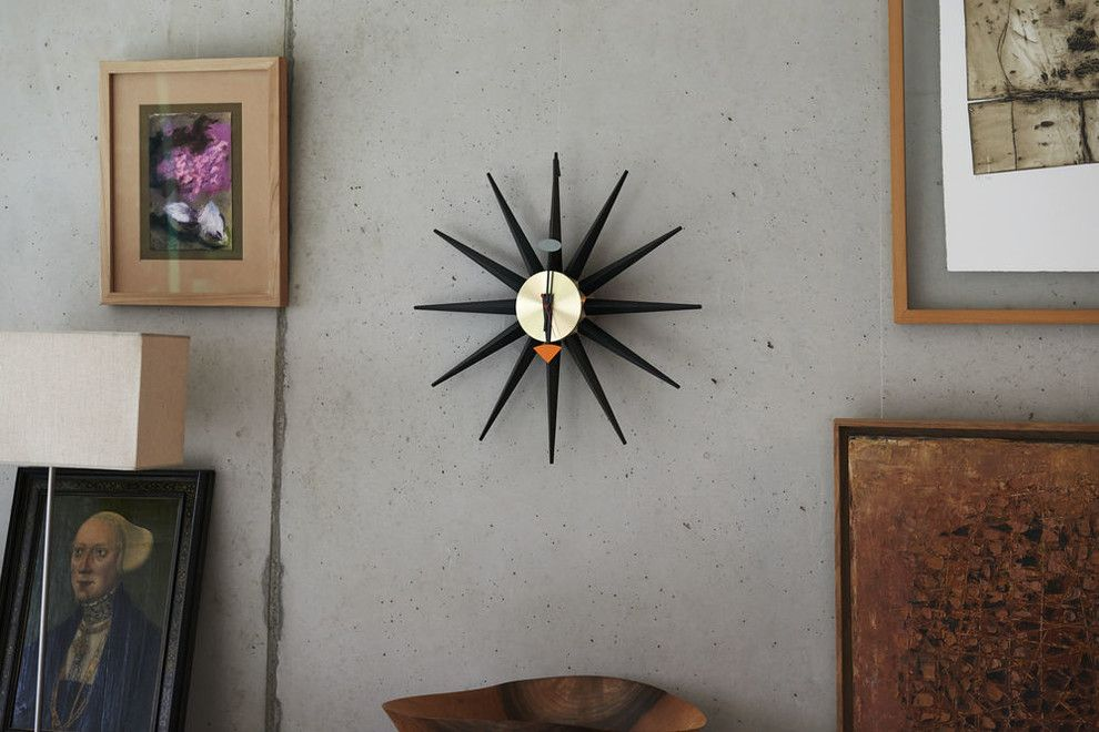 Hooked on Ornaments for a Contemporary Hall with a Vitra Eames Lounge Chair and Vitra Sunburst Wall Clock by Nest.co.uk