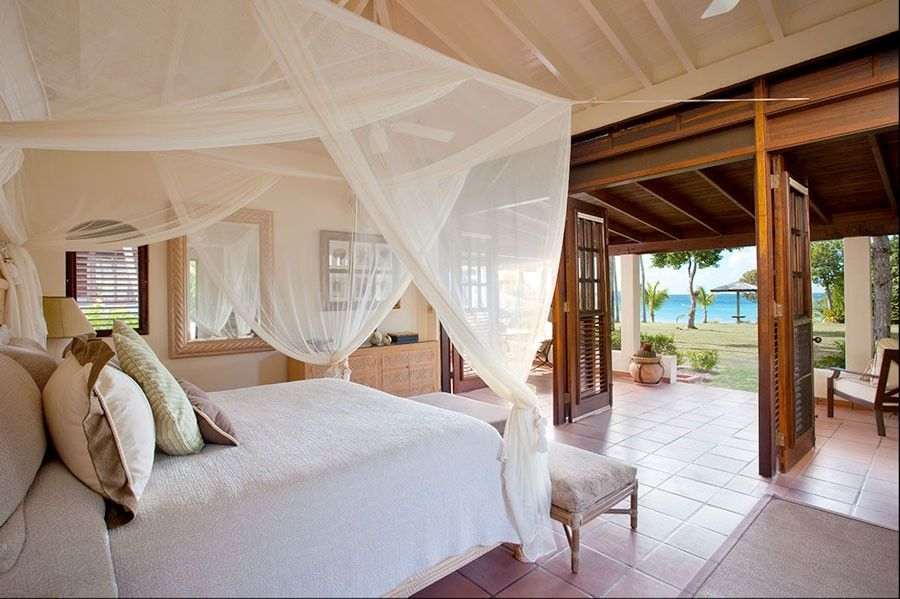 Hooks Chicken and Fish for a Tropical Bedroom with a Wood Ceiling and Bedroom Suite by Mcm Design