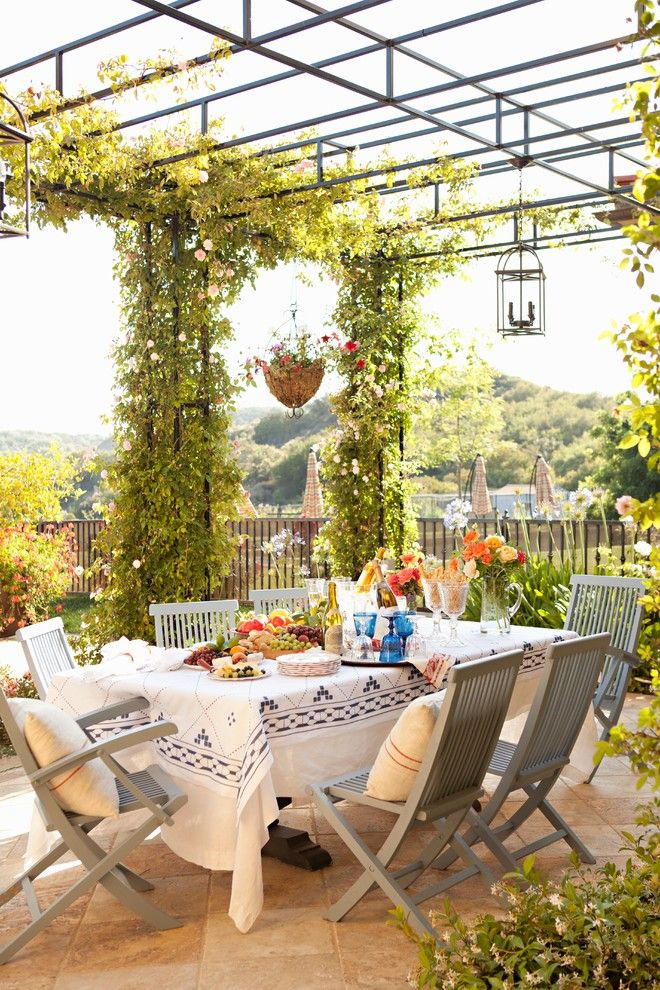 Hop Trellis for a Mediterranean Patio with a Outdoor Dining Area and Summit by Biglin Architectural Group