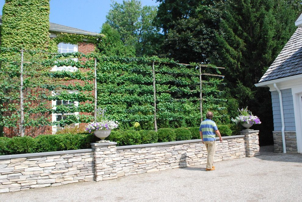 Hop Trellis for a Traditional Landscape with a Stone Planter Box and Lakefront Landscape by Deborah Silver and Co Inc