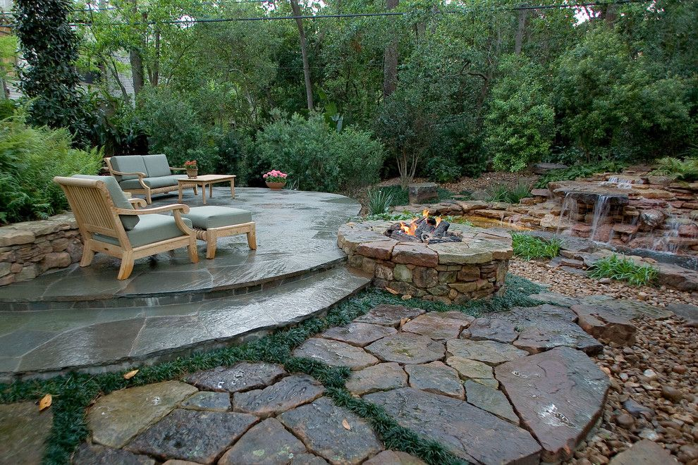 Hot Springs Spa Nc for a Tropical Patio with a Fire Pit and Natural Waterfall & Swimming Pool by Exterior Worlds Landscaping & Design
