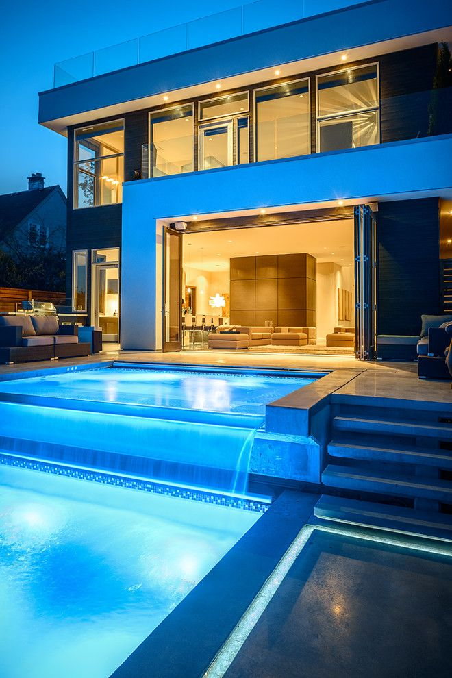 Hot Tubbing for a Contemporary Pool with a Folding Doors and Dwell on Despard by Joshua Lawrence Studios Inc