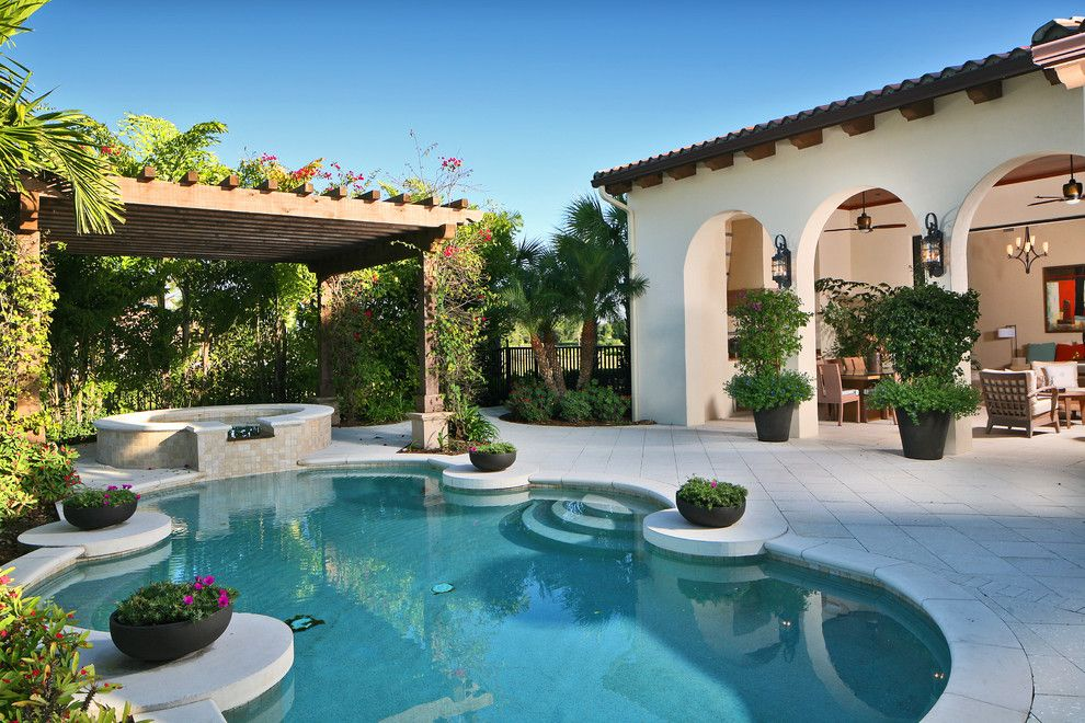 Hot Tubbing for a Mediterranean Pool with a Arch Entryway and Mediterranean Pool by Romanza.com