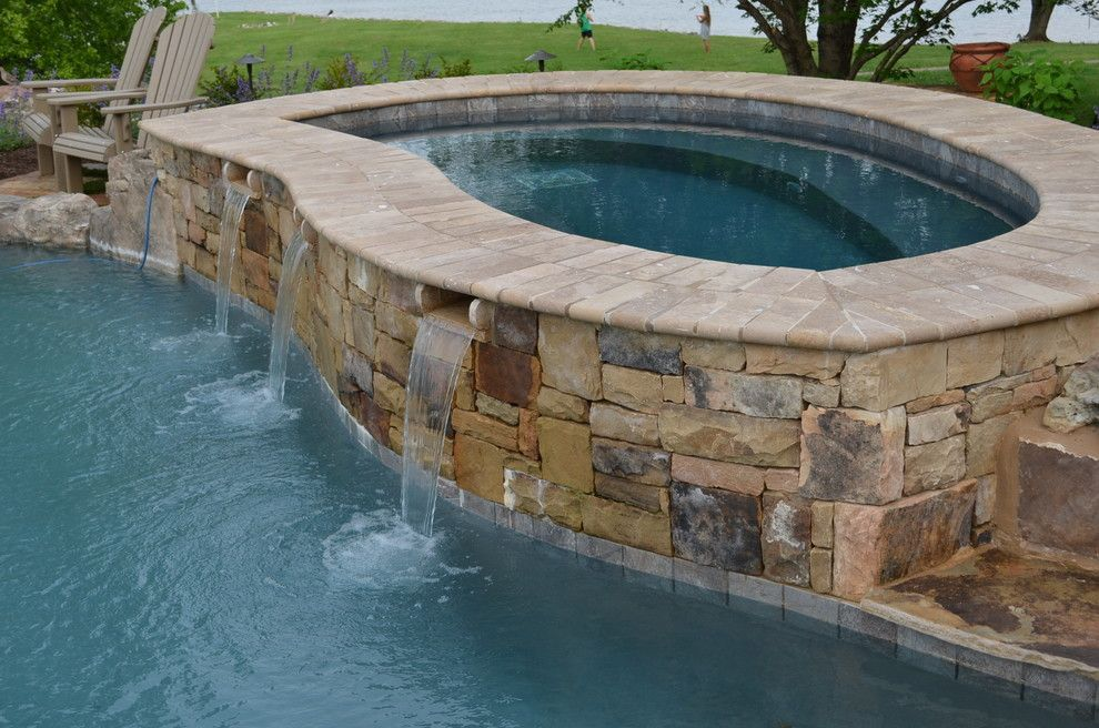 Hot Tubbing for a Traditional Pool with a Steps Into Pool and Lake Property with Infinity Edge Pool by the Easy Gardener