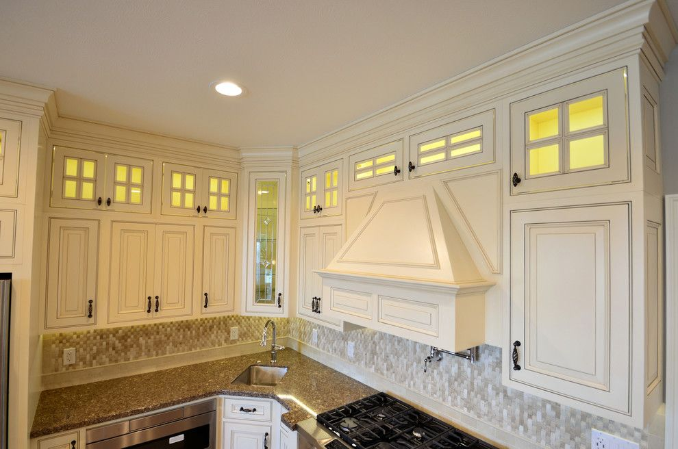 House Umber for a Transitional Kitchen with a Rough Edge and Custom Range Hood by Wolff Kitchen & Bath