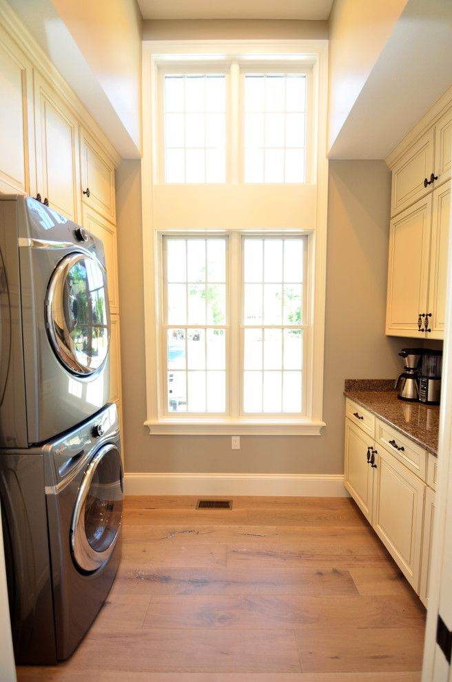 House Umber for a Transitional Laundry Room with a Kitchen Islands Carts and Laundry with a Veiw by Wolff Kitchen & Bath
