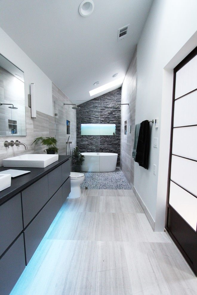 How Do Tankless Water Heaters Work for a Contemporary Bathroom with a Freestanding Vanity and Cool Gray by Change Your Bathroom, Inc.