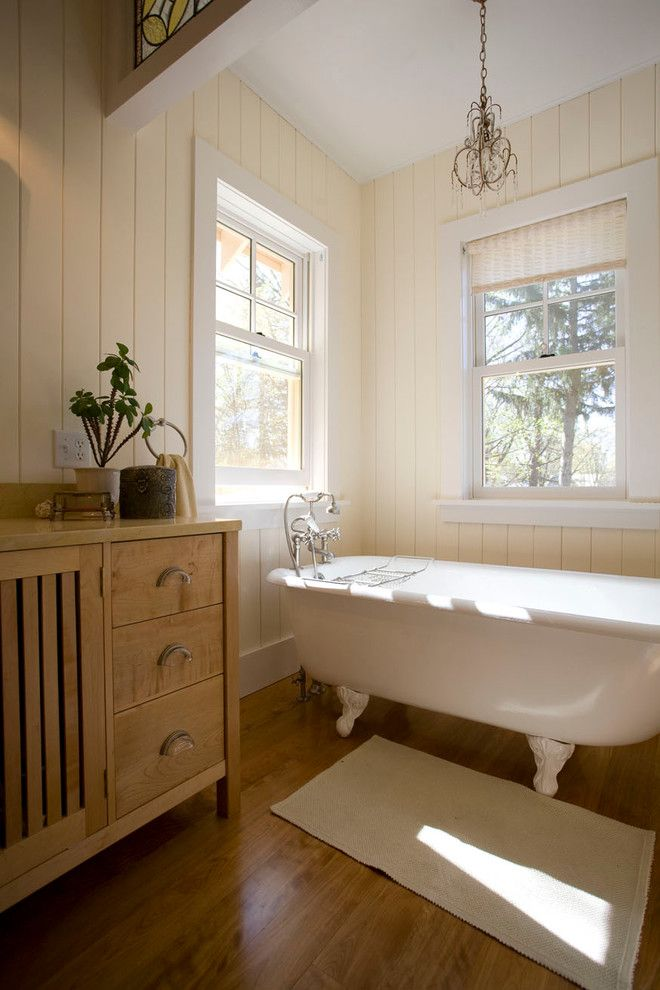 How Do Tankless Water Heaters Work for a Farmhouse Bathroom with a Vintage Tub and Custom Homes by Phinney Design Group