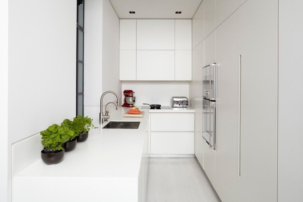 How Do Tankless Water Heaters Work for a Modern Kitchen with a White Walls and Mayfair Apartment by Tla Studio