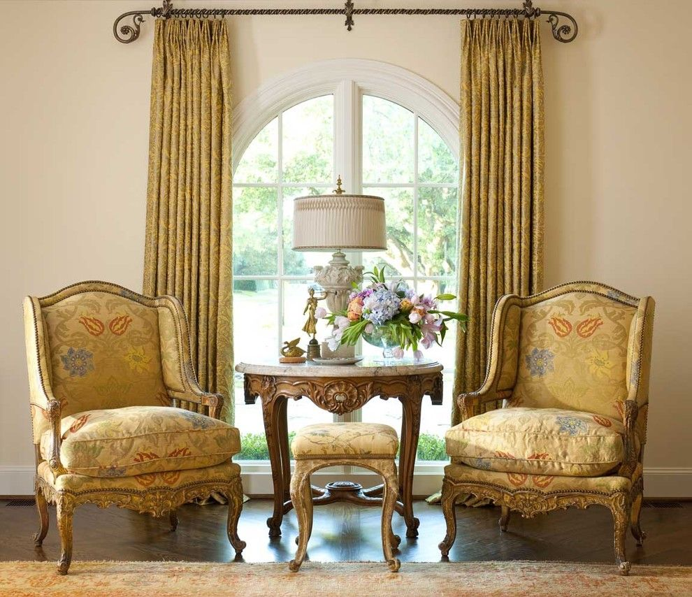 How Much Does It Cost to Reupholster a Chair for a Victorian Living Room with a Wood Floor and Living Spaces by Isler Homes